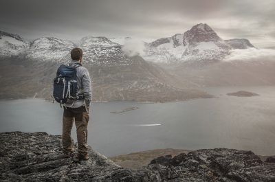 A hiker overlooking Kobberfjorden near Nuuk in Greenland - photo by Mads Pihl