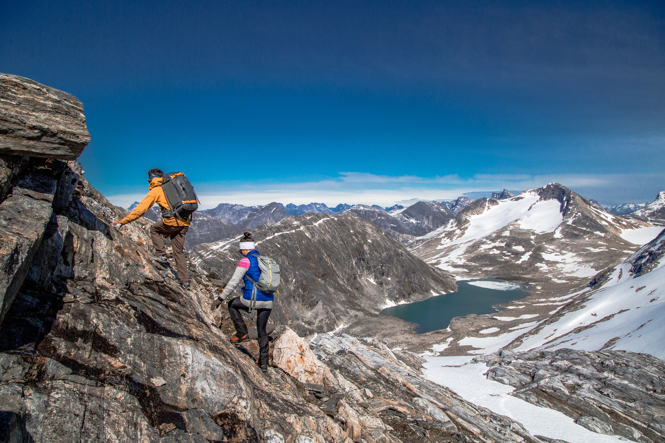 Two hikers nearing the summit of Kingittorsuaq mountain outside of Nuuk, the capital of Greenland